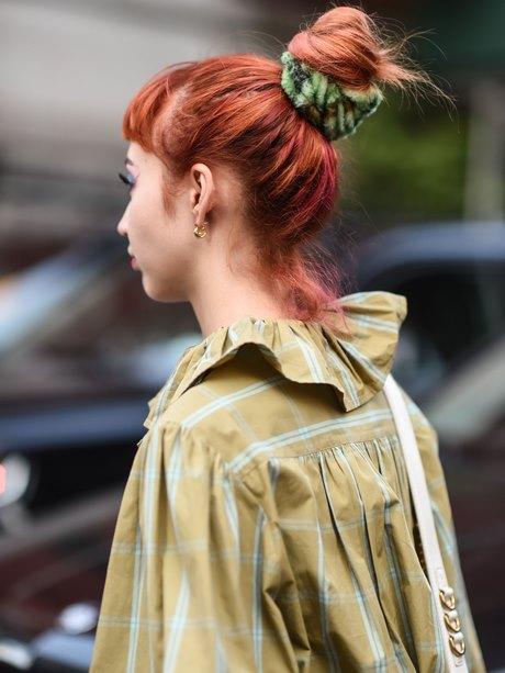 Coupe de cheveux femme court sur les cotés long dessus